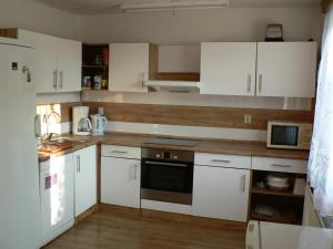 A kitchen or kitchenette at Chata Pod Hájkem