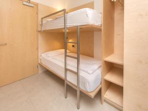 A bunk bed or bunk beds in a room at Albatros studio Classic