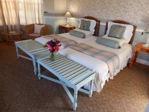 A bed or beds in a room at Westlodge B&B