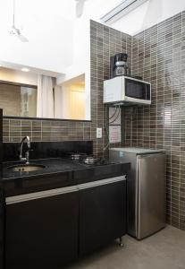 A kitchen or kitchenette at Passeio das Palmeiras