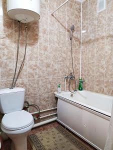 Ванная комната в One Bedroom Apartment on Shostakovich