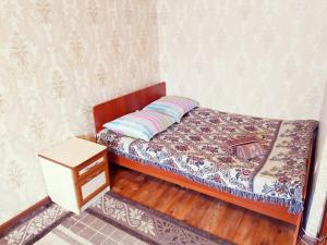 Кровать или кровати в номере One Bedroom Apartment on Shostakovich