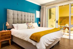 A bed or beds in a room at Primi Royal