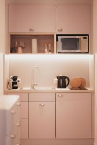 Küche/Küchenzeile in der Unterkunft Boardinghouse Sorgenfrei