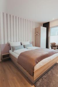 Ein Bett oder Betten in einem Zimmer der Unterkunft Boardinghouse Sorgenfrei