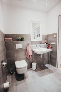 Ein Badezimmer in der Unterkunft Boardinghouse Sorgenfrei