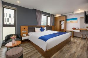 Кровать или кровати в номере Jolia Hotel & Apartment
