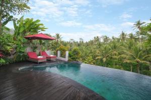 The swimming pool at or near Puri Sebali Resort