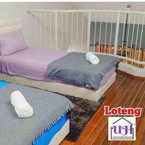 A bed or beds in a room at HOMESTAY PASIR GUDANG NEARBY MMHE, JOHOR PORT, TANJUNG LANGSAT, SENAI AIRPORT