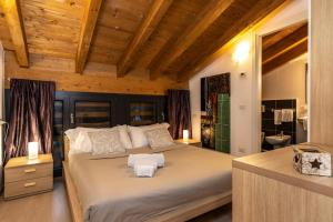 A bed or beds in a room at Il Giardino Di Lory