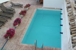 A view of the pool at Hotel Las Casas del Consul or nearby