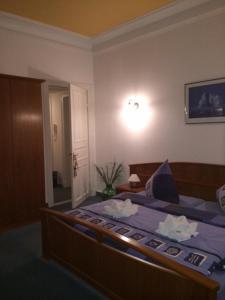 Ein Bett oder Betten in einem Zimmer der Unterkunft Villa Hebel