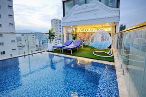 The swimming pool at or close to Alpha Bird Nha Trang Managed By VNServices