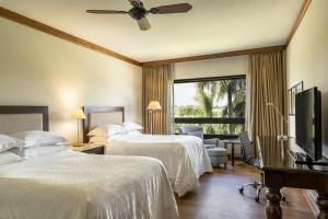 A bed or beds in a room at Sheraton Colonia Golf And Spa Resort