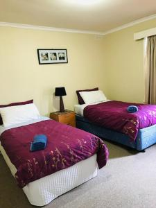 A bed or beds in a room at Yanakie Holiday House