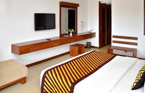 A bed or beds in a room at Goldi Sands Hotel
