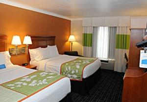 A bed or beds in a room at Fairfield Inn Ontario