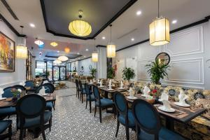 A restaurant or other place to eat at Babylon Premium Hotel & Spa