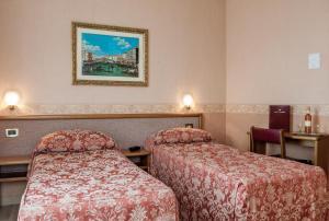 Cama ou camas em um quarto em Hotel Venezia