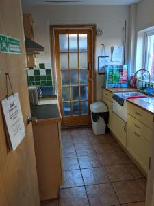 A kitchen or kitchenette at BASINGSTOKE B&b