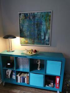A television and/or entertainment center at Gruga Apartment an der Messe