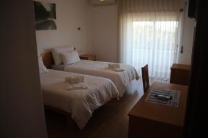 Uma cama ou camas num quarto em Hotel Solar da Charneca