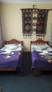 A bed or beds in a room at Guest House Emily