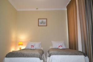 Кровать или кровати в номере Парк отель Мечта