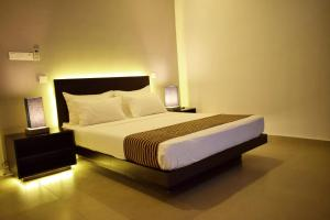 A bed or beds in a room at Residence Colombo 03