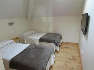 Cama o camas de una habitación en Posada Real El Brasilero