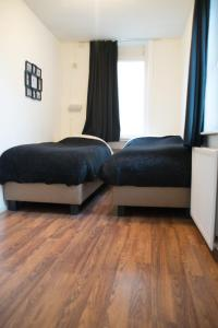 A bed or beds in a room at Appartement Lefferts