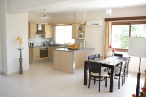 A kitchen or kitchenette at Holidays Villas