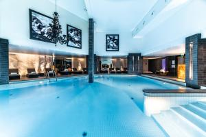 The swimming pool at or near Le Strato
