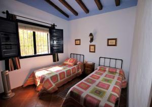 A bed or beds in a room at Villa Ruiz