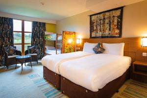 A bed or beds in a room at Chessington Hotel