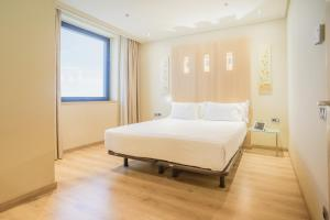 A bed or beds in a room at Abba Madrid