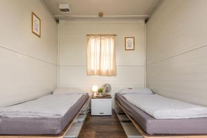Ein Bett oder Betten in einem Zimmer der Unterkunft Hannover Messe Camp