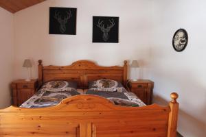 Ein Bett oder Betten in einem Zimmer der Unterkunft Ferienwohnung Landhausliebe