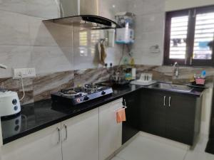 A kitchen or kitchenette at Swag Boutique Apartment