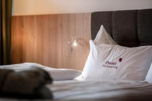 Ein Bett oder Betten in einem Zimmer der Unterkunft Hotel Belvedere