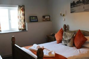 A bed or beds in a room at Littledean House Hotel