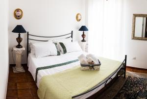 Letto o letti in una camera di Villa Vittoria