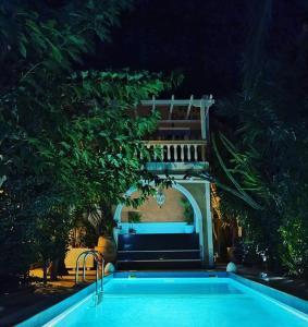 The swimming pool at or near Danae Villa