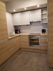 Kuchnia lub aneks kuchenny w obiekcie Sweet Apartments