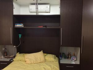 A bed or beds in a room at Casa Barra Nova
