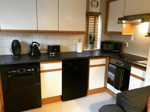 A kitchen or kitchenette at Clarabel's Guest House- The Nook