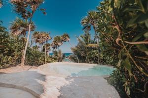 The swimming pool at or near Papaya Playa Project