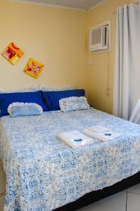 Cama ou camas em um quarto em Pousada Luzes de Geribá