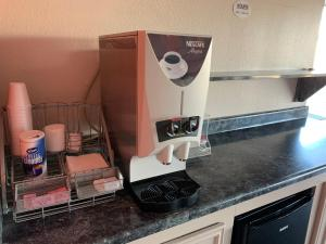 Coffee and tea-making facilities at Americas Best Value Inn Hobby Airport