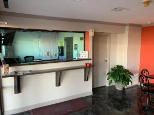 The lobby or reception area at Americas Best Value Inn Hobby Airport